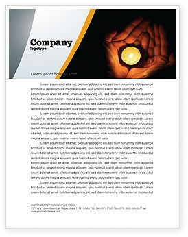 Candle In Hands Letterhead Template, 05771, Religious/Spiritual — PoweredTemplate.com
