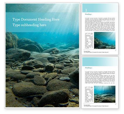Nature & Environment: Plantilla de Word gratis - rayos de sol bajo el agua con rocas en el fondo del mar #15932