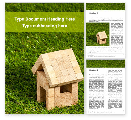 General: Toy Wooden House in the Grass Presentation #16563