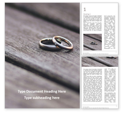 Holiday/Special Occasion: Two Wedding Rings on Wooden Surface Word Template #16674