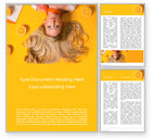 People: Portrait of Blonde Girl Lying on Yellow Background with Oranges Word Template #15749