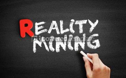 Business: Reality minin text on blackboard #00300