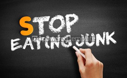 Business: Stop Eating Junk text on blackboard #00917