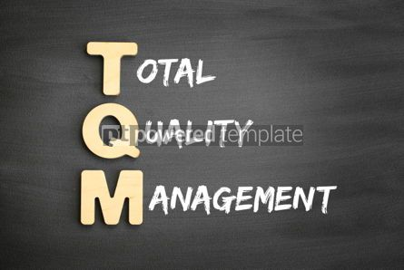 Business: Wooden alphabets building the word TQM #01456