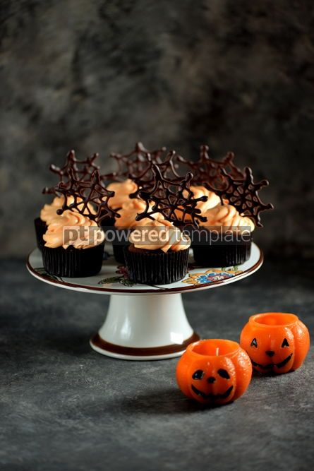 Food & Drink: Chocolate cupcakes with pumpkin cream and chocolate spider web. Dessert for Halloween. #02195