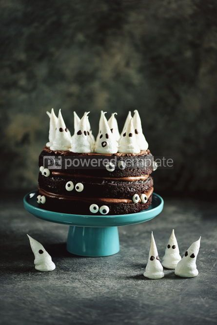 Food & Drink: Homemade Chocolate Cake with Chocolate cream and Meringue Ghost and Eyes for Halloween Party. #02197