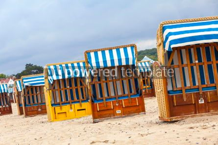 Nature: Hooded beach chairs (strandkorb) at Baltic seacoast in Travemund #03227