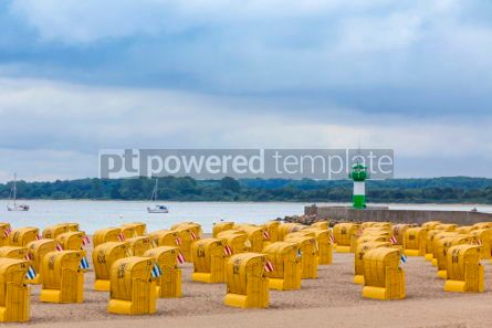 Nature: Hooded beach chairs (strandkorb) at Baltic seacoast in Travemund #03230