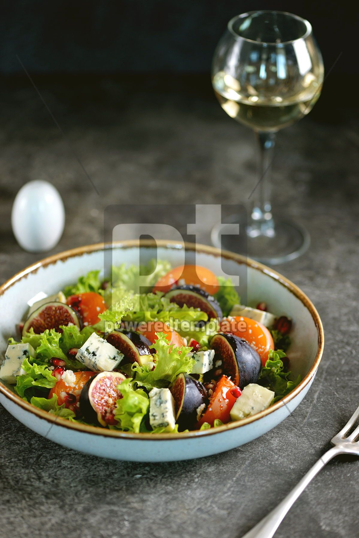 Healthy salad of persimmons figs blue cheese pomegranate seeds lettuce and olive oil., 03247, Food & Drink — PoweredTemplate.com