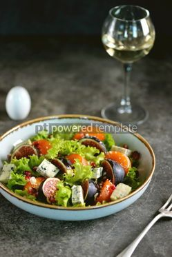 Food & Drink: Healthy salad of persimmons figs blue cheese pomegranate seeds lettuce and olive oil. #03247