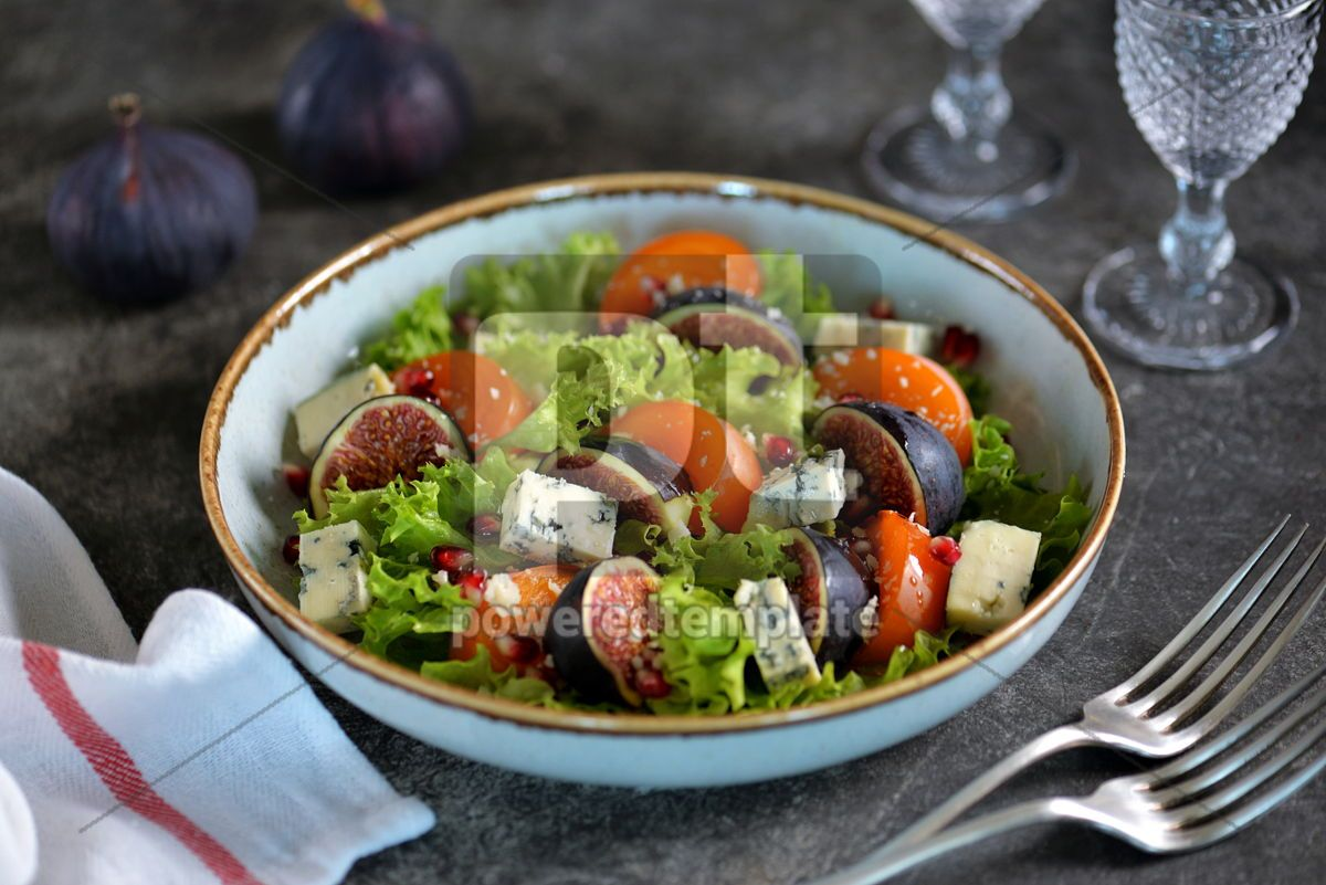 Healthy salad of persimmons figs blue cheese pomegranate seeds lettuce and olive oil., 03248, Food & Drink — PoweredTemplate.com