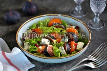 Food & Drink: Healthy salad of persimmons figs blue cheese pomegranate seeds lettuce and olive oil. #03248