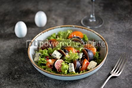 Food & Drink: Healthy salad of persimmons figs blue cheese pomegranate seeds lettuce and olive oil. #03249