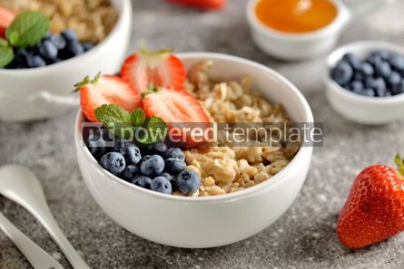 Food & Drink: Oatmeal porridge with organic blueberries strawberries honey and mint. #03252
