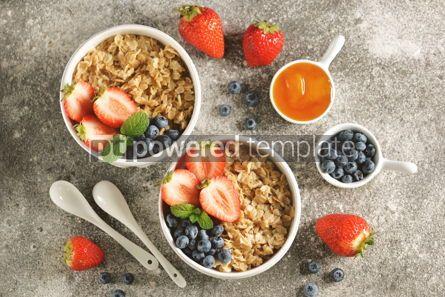 Food & Drink: Oatmeal porridge with organic blueberries strawberries honey and mint. #03253