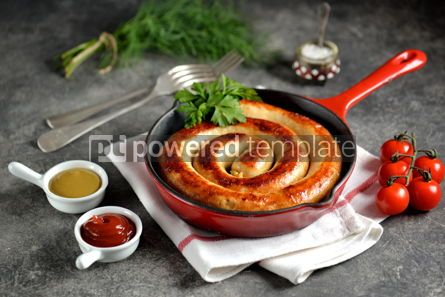 Food & Drink: Grilled homemade sausage in a cast iron pan. Delicious homemade food. #03254