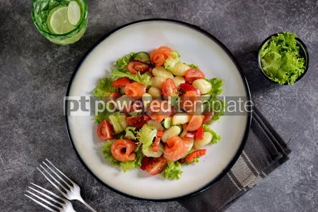 Food & Drink: Healthy potato gnocchi salad with cherry tomatoes cucumber bell pepper salted salmon olive oil  #03258
