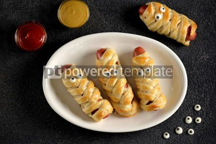 Food & Drink: Funny sausage mummies in dough with ketchup and mustard  for the Halloween party.  #03260
