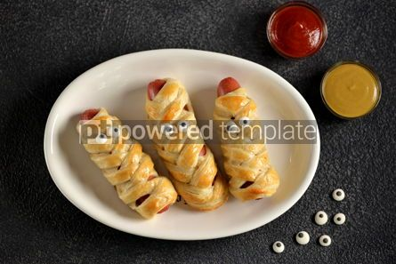 Food & Drink: Funny sausage mummies in dough with ketchup and mustard  for the Halloween party.  #03261