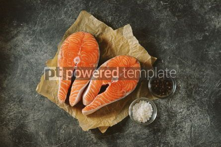Food & Drink: Two fresh raw salmon steaks on a gray concrete background. Healthy food.  #03278