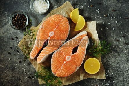 Food & Drink: Two fresh raw salmon steaks on a gray concrete background. Healthy food.  #03286