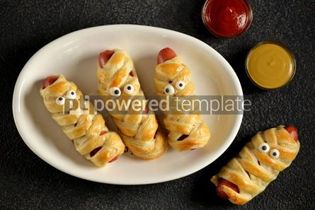 Food & Drink: Funny sausage mummies in dough with ketchup and mustard  for the Halloween party.  #03298