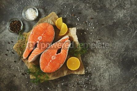 Food & Drink: Two fresh raw salmon steaks on a gray concrete background. Healthy food.  #03303