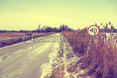 Nature: Winter road with old speed limit sign #03317