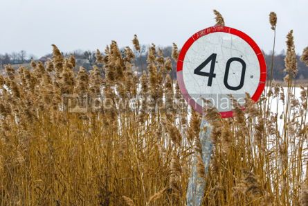 Nature: Old speed limit sign on the side of the road #03318