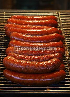 Food & Drink: Traditional fresh polish sausages grilled on wire rack outdoor #03455