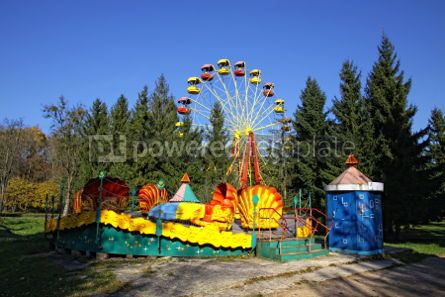 Architecture : Vintage Merry-Go-Round and Ferris wheel in an amusement park #03477