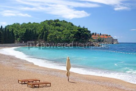 Nature: Empty beach with two chairs and umbrella near Sveti Stafan islan #03575