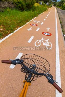 Transportation: Bicycle steering wheel and bicycle lanes with roadsigns #03885