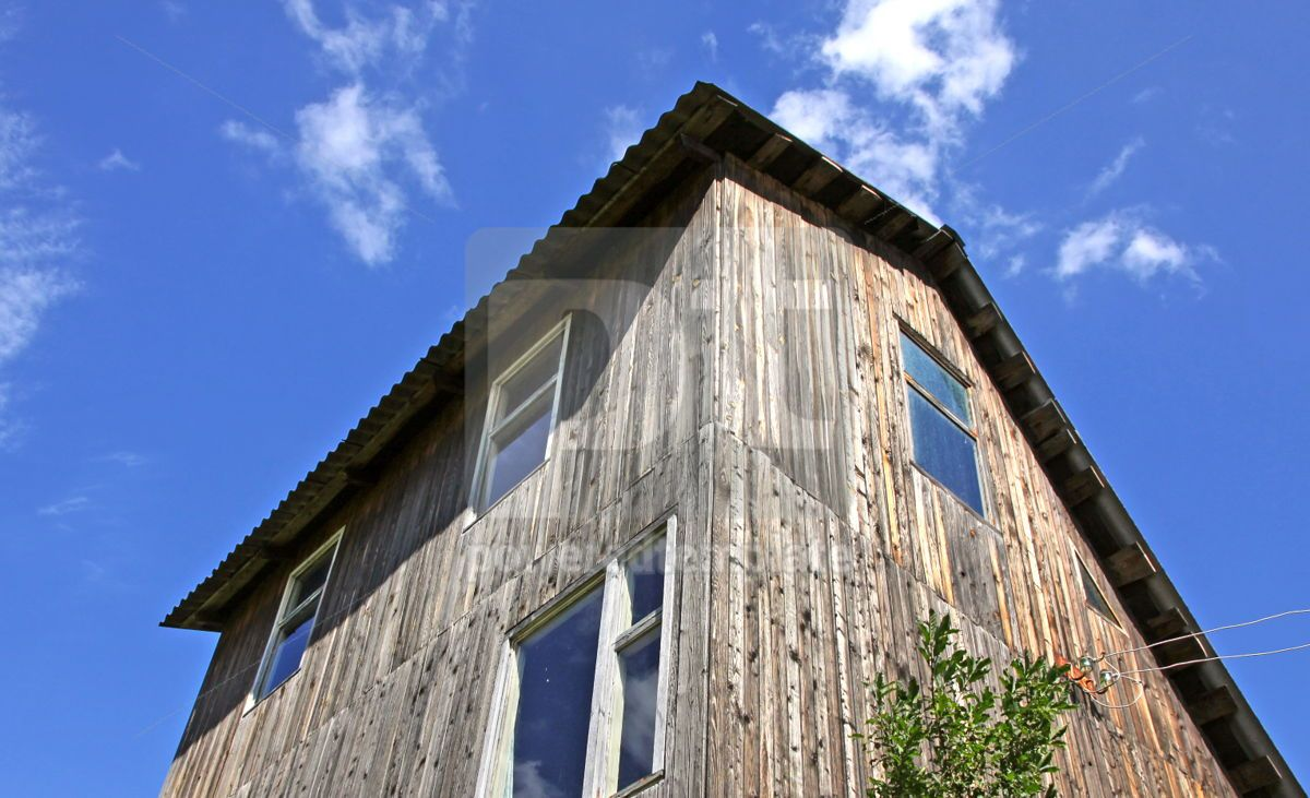 Vintage brown wooden cottage with blue sky background, 03991, Architecture  — PoweredTemplate.com