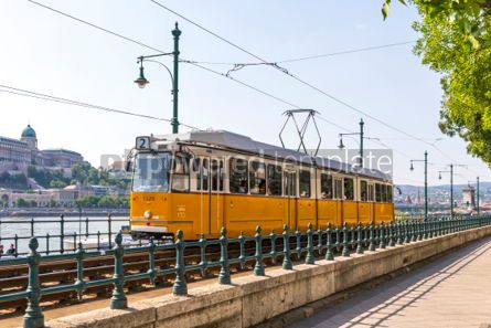 Transportation: Tram moves along Danube river in Budapest Hungary #04143