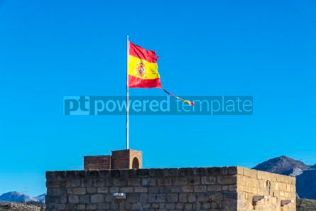 Education: Torn Spanish flag waving on the wind #04270