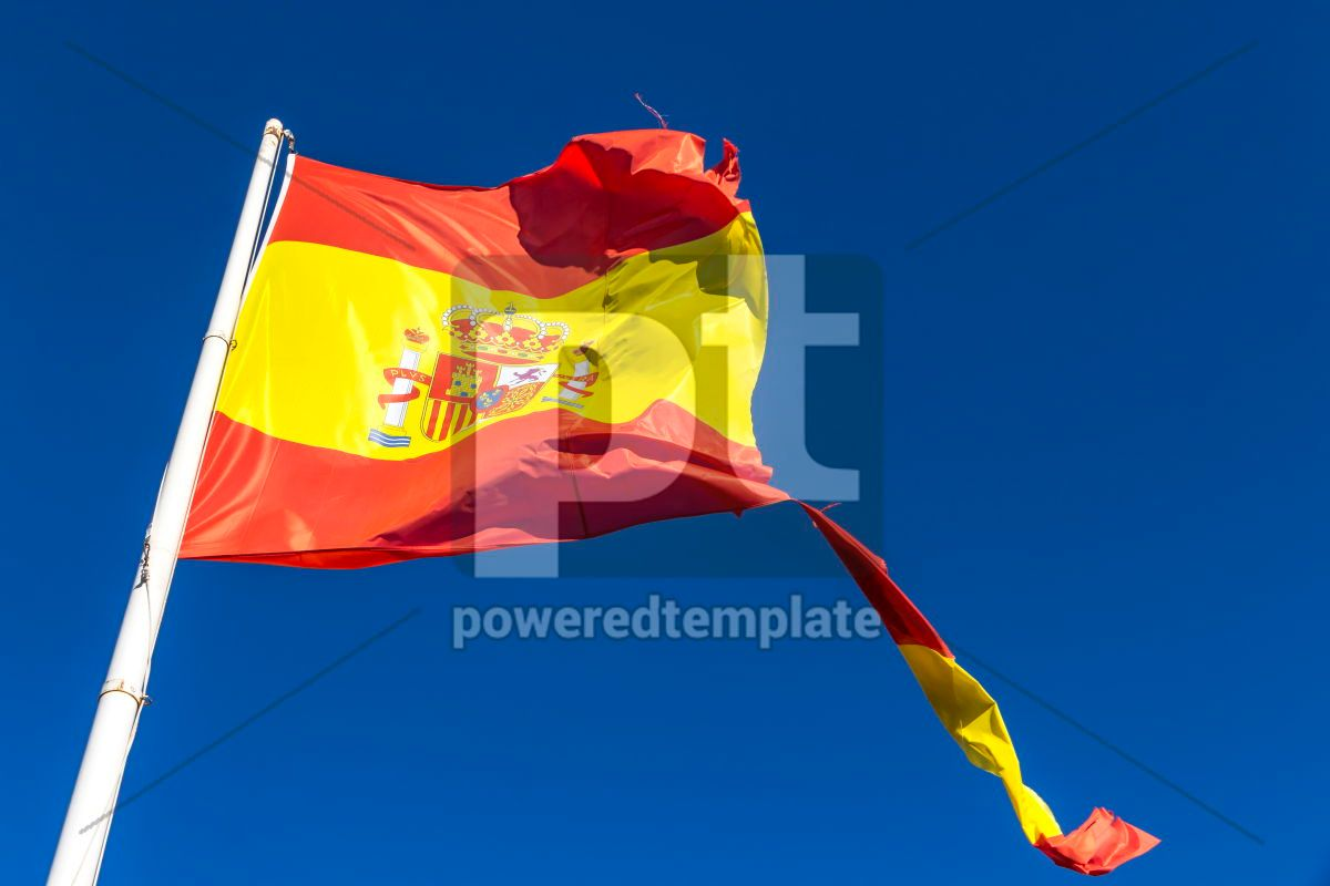 Torn Spanish flag waving on the wind, 04271, Education — PoweredTemplate.com