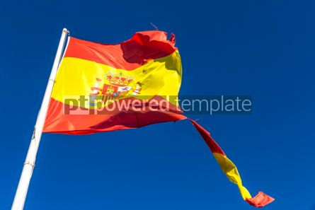 Education: Torn Spanish flag waving on the wind #04271