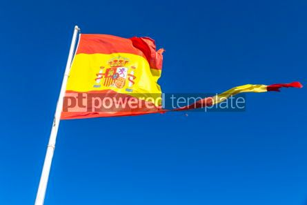 Education: Torn Spanish flag waving on the wind #04272