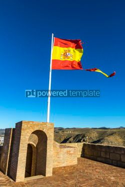 Education: Torn Spanish flag waving on the wind #04273