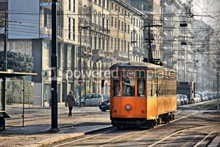 Transportation: Old vintage orange tram on the street of Milan Italy #04316