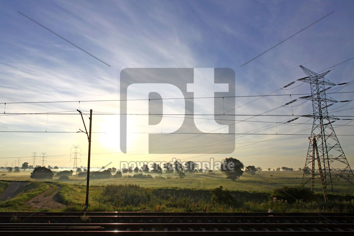 Sun rising behind electricity pylon and railroad tracks, 04331, Nature — PoweredTemplate.com