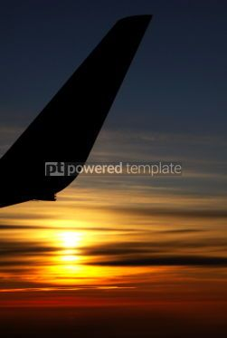 Nature: Sunrise over clouds with contour of airplane wing #04342