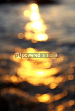 Abstract: Out of focus bokeh background of sea water with sun reflections #04344