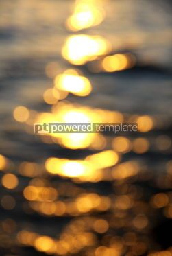 Abstract: Out of focus bokeh background of sea water with sun reflections #04345
