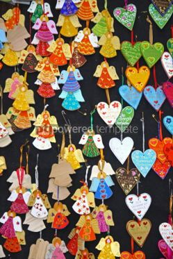 Holidays: Close up small handmade Christmas angels on a market stall #04348