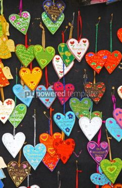Holidays: Close up small handmade hearts on a market stall #04349