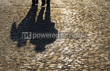 People: Silhouette and shadows of people walking on brick pavement #04473