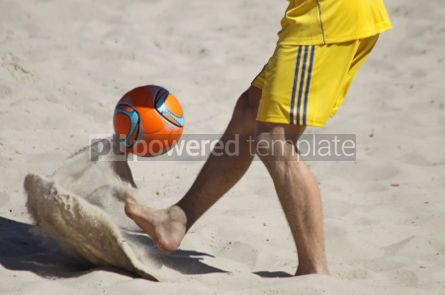 Sports: Man playing soccer on a beach #04592