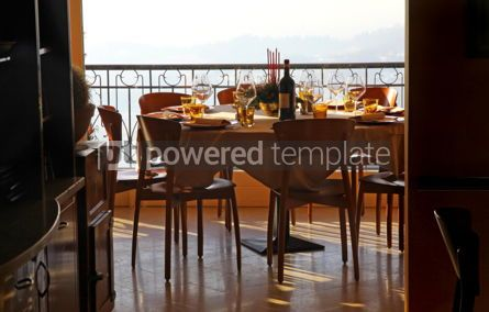 Food & Drink: Table with bottle of wine and wine glasses at a restaurant #04720